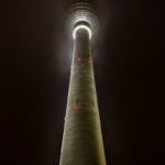 Berlin TV Tower at night with fog